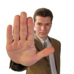 3847646-man-holding-up-his-hand-in-protest-gesture-on-white-background